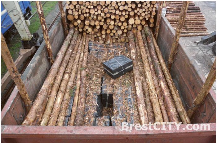 Контрабанда сигарет в ЖД вагоне с лесоматериалами
