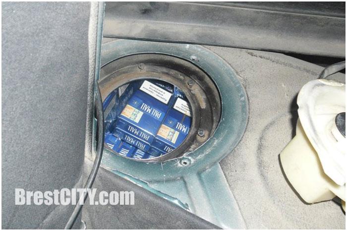 Тайник с сигаретами в топливном баке автомобиле ауди